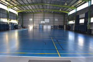 The inside of our Basketball Court Size Activities Hall. The floor is polymer sprung on wood beams to allow best protection and playing surface for our students.